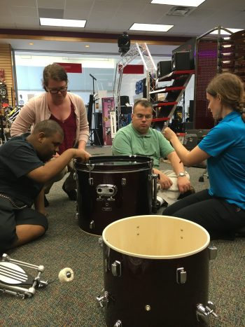 Melodic Connections putting drum set together