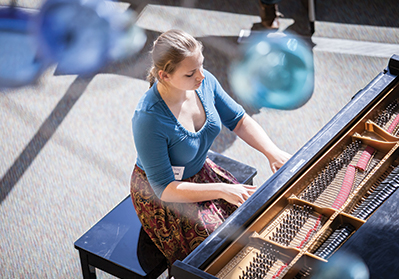 SCPA student sitting at a piano playing. Shot taken from above looking down