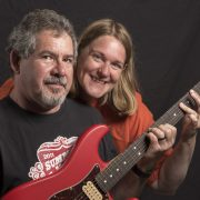 Jim and Denise with a guitar