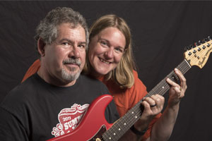 Jim and Denise with a Fender Guitar
