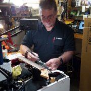 Mike repairing a guitar