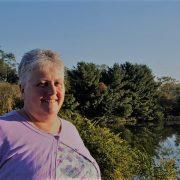 Judy by a pond