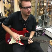 Tanner playing guitar
