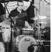 Kevin black and white playing drums