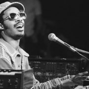 Young Stevie Wonder playing piano