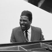 Picture of Thelonious Monk at the Piano smiling
