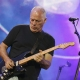 DAvid Gilmour playing a guitar on stage